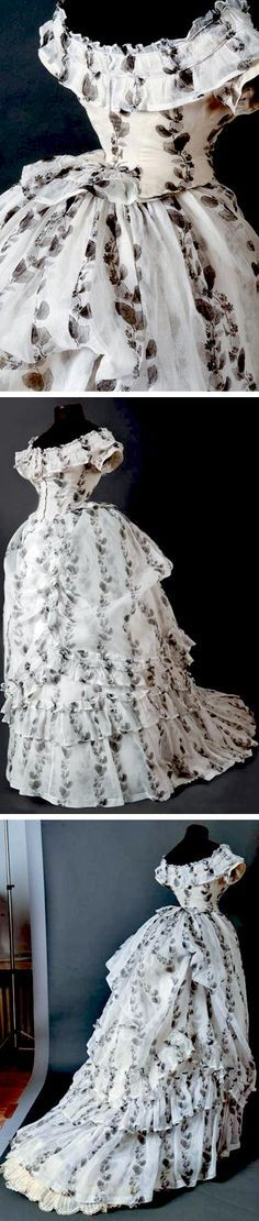 Afternoon dress ca. 1874, in black & cream organza. Boat neckline, ruffled skirt with short train, apron draped with beautiful transparency effects and overlay printed decoration, weights to retain dress's shape. Drouot Auctions