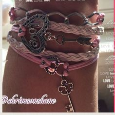"""JUST 1 LEFT! Lovely bracelet with pink and white PU leather cord and silver tone charms. Clasps at back. Adjustable 7.5-9.5.""""New in package. 10 each or bundle to save Top-Rated Seller Fast Shipper Top 10% Seller Discount on Bundles Free Gift For All Orders $20 & up No Paypal No Trades Jewelry"""