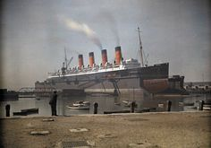 """Rare color photos of 1928 England, A view of the Cunard SS """"Mauretania"""" at dock, in Southampton, Hampshire."""