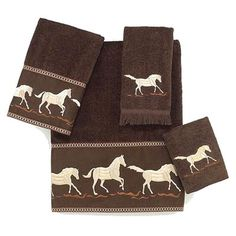 The On The Range Bath Towel set features intricately embroidered ivory horses on a dark chocolate brown 100% cotton towel.
