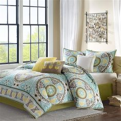 Get+a+taste+of+Indonesia+in+your+bedroom+with+the+Samara+Comforter+Collection.+The+200+thread+count+cotton+sateen+comforter+and+shams+feature+dusty+shades+of+green,+teal,+brown+and+yellow
