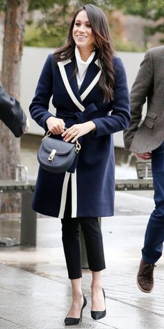 On International Women's Day, Meghan Markle wrapped a sold out J.Crew coat over a white All Saints turtleneck (the black and blue versions are still up for grabs). Black trousers and matching Manolo Blahnik pumps ($625; nordstrom.com) completed her winning outfit. And we can't forget to mention that beautiful Altuzarra bag ($1,595; barneys.com), which Markle owns in other colorways as well.