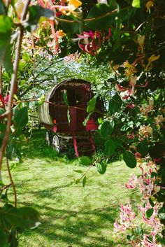 Caravan at the end of the garden, a perfect place to nap in the afternoon or run away to read a great book.  Wonder what the inside is like?