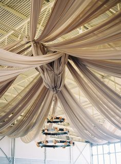 I might need more frost cloth for this..!  airplane-hanger-reception-fabric-ceiling-chandelier via Once Wed.