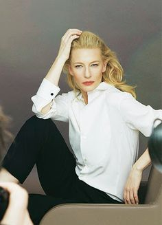 Cate Blanchett in classic white button down and black cigarette pants.