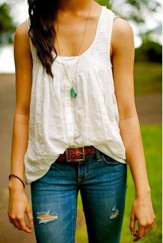 Flow-y tank, tucked in the center Cute big pendant necklace Distressed denim Curly hair