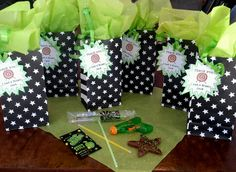 Laser Tag Party Favors. Rock candy, Pop Rocks, squrit guns, Glow Sticks & Star Cookies.