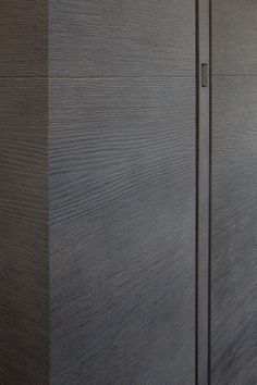 Detail of a paneling in oak, sliding door by Deco-Lust. photo by T. De Bruyne