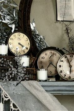 black and white vintage clocks on mantel
