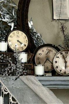 black and white vintage clocks on mantel