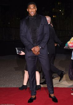 Out of the ring and into the style books! British boxer Anthony Joshua cut a seriously suave figure in his dark navy tuxedo; a look he may replicate at the premiere of his own movie if rumours about a biopic are to be believed