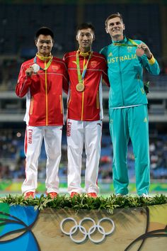 Zhen Wang of China (C) poses with the gold medal, Zelin Cai of China (L) with the silver medal and Dane Bird-Smith of Australia with the bronze medal for the Men's 20km Race Walk on Day 7 of the Rio 2016 Olympic Games at the Olympic Stadium on August 12, 2016 in Rio de Janeiro, Brazil.