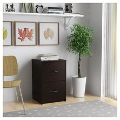 Prevent clutter when you add a storage accessory to your home office or bedroom with the 2-Drawer File Cabinet from Ameriwood Home. Made from durable laminated particleboard, this cabinet boasts refined lines and decorative handles that create a sleek yet classic look in your decor. The two spacious drawers allow you to store letter-sized documents and can support up to 25 pounds for an ideal organization item for your home.
