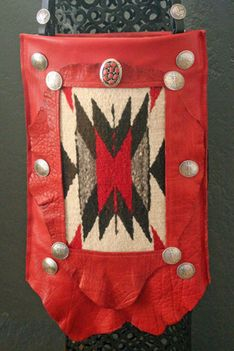 New Mexico Artist, Ifania has created the ifania ® Heritage Series western bag in the spirit of Santa Fe, Taos, and Albuquerque, New Mexico, artisan made in the USA from traditional buffalo leather but in an vibrant red coupled with sterling and coral bolo and Liberty and eagle conchos with a luxurious leather interior.  One of a kind.  ifaniadesigns.com bolotradingcompany.com