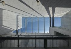 An opaque box appears to balance over see-through walls of glass and perforated steel at this house and pet shop in Saitama, Japan, by architecture studio N Maeda Atelier