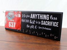 Running Medal Holder and Race Bib Holder with running quote by Steve Prefontaine To Give Anything Less Than your Best is to Sacrifice the Gift. - listing shown in Black.  What a great way to display your hard earned race medals. This will be a beautiful addition to your home decor that will allow you to Strut Your Stuff in style. Brag on yourself and your accomplishments. You may encourage others to become active and experience the same successes you have. This also makes a great gift for…