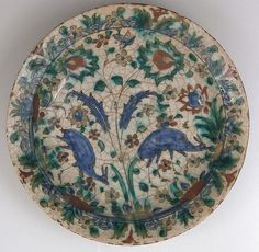 Dish,17th century, Iran Stonepaste; underglaze painted in black, blue, and green with red and yellow slips