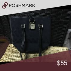 Gorgeous Black Dooney & Bourke Purse Authentic Dooney & Bourke black purse in excellent condition inside and out. Color is black which will never go out of style. Top zips and closes via metal lock. Shoulder strap - great size to fit wallet, phone and other items but not super large. Dooney & Bourke Bags Shoulder Bags