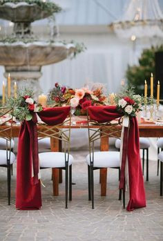 Swag Of Fabric And Bouquets Blooms Decorate Wedding Chairs Chair Decorations Themes