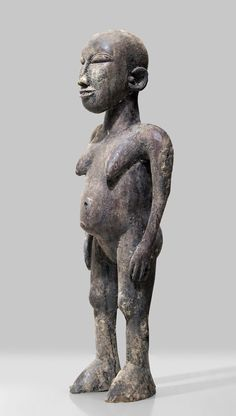A Lobi sculpture of Youl Bolare with traces of ritual use
