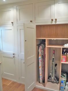 floor to ceiling cupboards - i don't want to see any of that laundry/cleaning crap anywhere! and a cupboard big enough for Henry Hoover please.