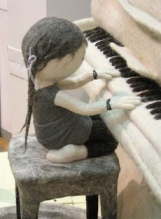 A girl playing the piano. Felted composition by Russian artist Irina Andreeva