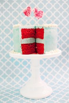 A red velvet cake with mint-colored frosting