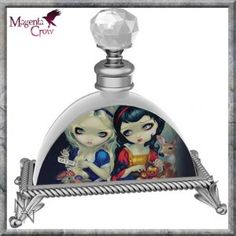 Glass Perfume Bottle Alice and Snow White by Jasmine Becket Griffith. Beautiful traditional glass perfume bottle that is ready to be filled with your favourite perfume and add some fantasy to your bedroom décor. This colourful, detailed and elegant perfume bottle features the artwork of fantasy artist Jasmine Becket Griffith. A beautifully printed front featuring  Alice and Snow White sat together, Alice of course is shown with the mushrooms that by eating led to her adventure, and Snow…