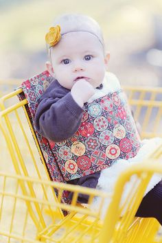 Kanga Boo is a support belt that attaches to shopping carts making a stable seat for Infants and Toddlers. Fabric: yellow/multi color