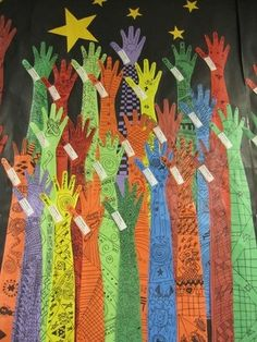 beginning of year bulletin board. Kids arms with their goals written on them, with the arms reaching toward the stars.
