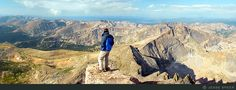 The Fourteener  A hiker enjoys the sweeping views of the Front Range from the summit of 14,000-foot Longs Peak, Colorado