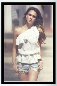 Buy it: Jessica Alba's White Eyelet Top and Pale-Blue Distressed Denim Shorts
