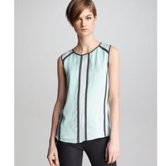J Brand RTW mint sleeveless silk blouse top Like new, worn ONCE. Beautiful mint blouse with black contrast lines. The J Brand Ready To Wear Isabella top boasts striking contrast outlines for a dynamic presentation. AS SEEN ON REVENGE. Crepe. High scoop neckline. Sleeveless; wide shoulder coverage. Relaxed silhouette. Silk. Imported. J Brand Tops Blouses