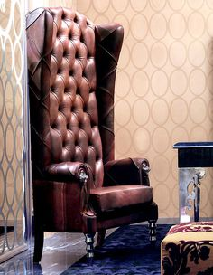 high-back armchair for sipping tea at the fireplace... What a chair!!