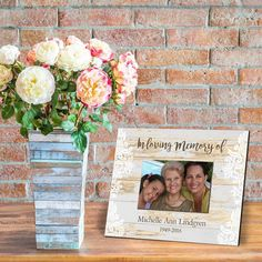 """Commemorate loved ones with a personalized memorial picture frame. The versatile, rustic design is suitable for a wide range of home décor, and can be customized as appropriate with the name and dates to be memorialized. Suitable for standard landscape format photographs, this is a meaningful, attractive and purposeful gift. Item Specifications: Personalize with 2 lines allowing up to 15 characters per line Measures: 8""""x10"""", holds a 4""""x6"""" picture Two options: Whitewash or Dark Brown Colorful Picture Frames, Picture Frames For Sale, White Picture Frames, Personalized Memorial Gifts, Personalized Picture Frames, Funeral Memorial, Character Home, Sympathy Gifts, Rustic Design"""