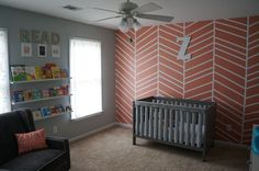Coral Herringbone Accent Wall - such a fun, yet on-trend touch to this bright nursery!