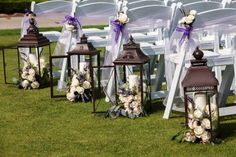 Flower filled lanterns for the aisle :  wedding candles and flowers ceremony diy flowers flowers for aisle lanterns lavender and roses purple Chandra  Matt 0197 X3