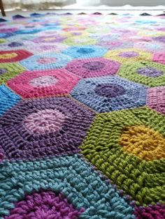 From Erica Hills' Simply Crochet: I need to get the directions on how to make this hexagon block from another site. However, I love the colors and idea and can't wait to try to put one of these together. - Pam