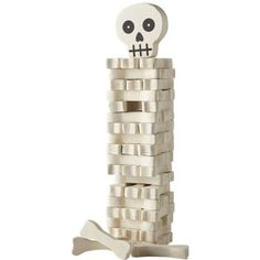"""See how high you can stack the bones and this spooky wood block game. Pull out the lower blocks and stack them on top without toppling the skeleton. For 1 or more players.<br><br>Size - 11.5"""" x 3"""
