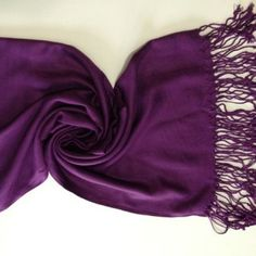 Grape purple pashmina scarf Perfect for dressy occasions, work place, or just to bring with you for cold nights in your bag. Purple color with fringe at the ends. Picture 3 and 4 are pictures of the actual scarf. Features a really light pretty swirl pattern in picture 3. boutique Accessories Scarves & Wraps