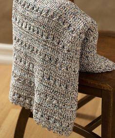 Softly textured crochet afghan is a terrific project for beginners and advanced crocheters alike and makes a quick and easy gift or fresh accent for your home.