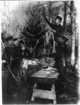 Weihnachtsfeier deutscher Landsturmleute an der Front - German soldiers decorating  a Christmas tree while stationed near the front lines circa 1914-1918
