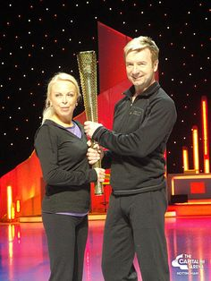 Torvill & Dean holding the Olympic Torch in Dancing on Ice - 20th april 2012
