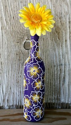 Hand Painted Wine bottle Vase, Up Cycled, Purple, White and Yellow, Bold Wildflower Design #paintedwinebottles