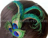 Jenn (aka Bobo) check this out.....peacock feathers!!!!  Sweet Grass Mill Peacock Clips & Headbands ~ Feather Hats ~ Shoe Clips ~ etc.