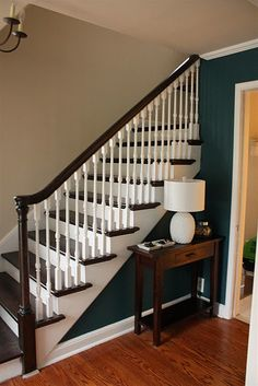 Like this dark wood handrail and dark paint in contrast to white