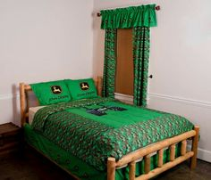 John Deere cover and curtains on cedar bed
