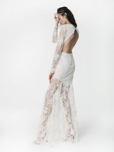 Houghton Wilkinson Gown in Ivory Chantilly Lace with a boat neck, open back, and sheer skirt and sleeves.  www.houghtonnyc.com #houghton #houghtonnyc #houghtonbride