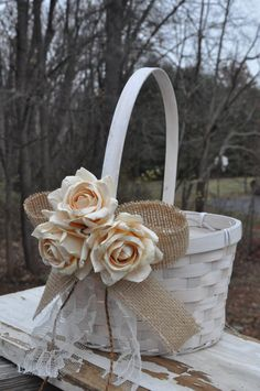 Burlap and Lace Flower Girl Basket - Rustic Flower Girl Basket - Burlap: Etsy. I like the bow and lace, maybe do flowers like the one on her dress instead?