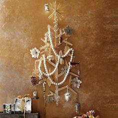 back to basics triangle tree...http://www.trendir.com/dining-entertaining/wall-christmas-tree-ideas-top-20-for-2012.html